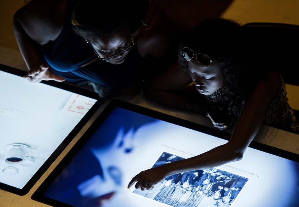 Visitors try out one of the interactive displays at the National Museum of African American History and Culture on Wednesday, Sept. 14, 2016. (Bill Clark/CQ Roll Call)