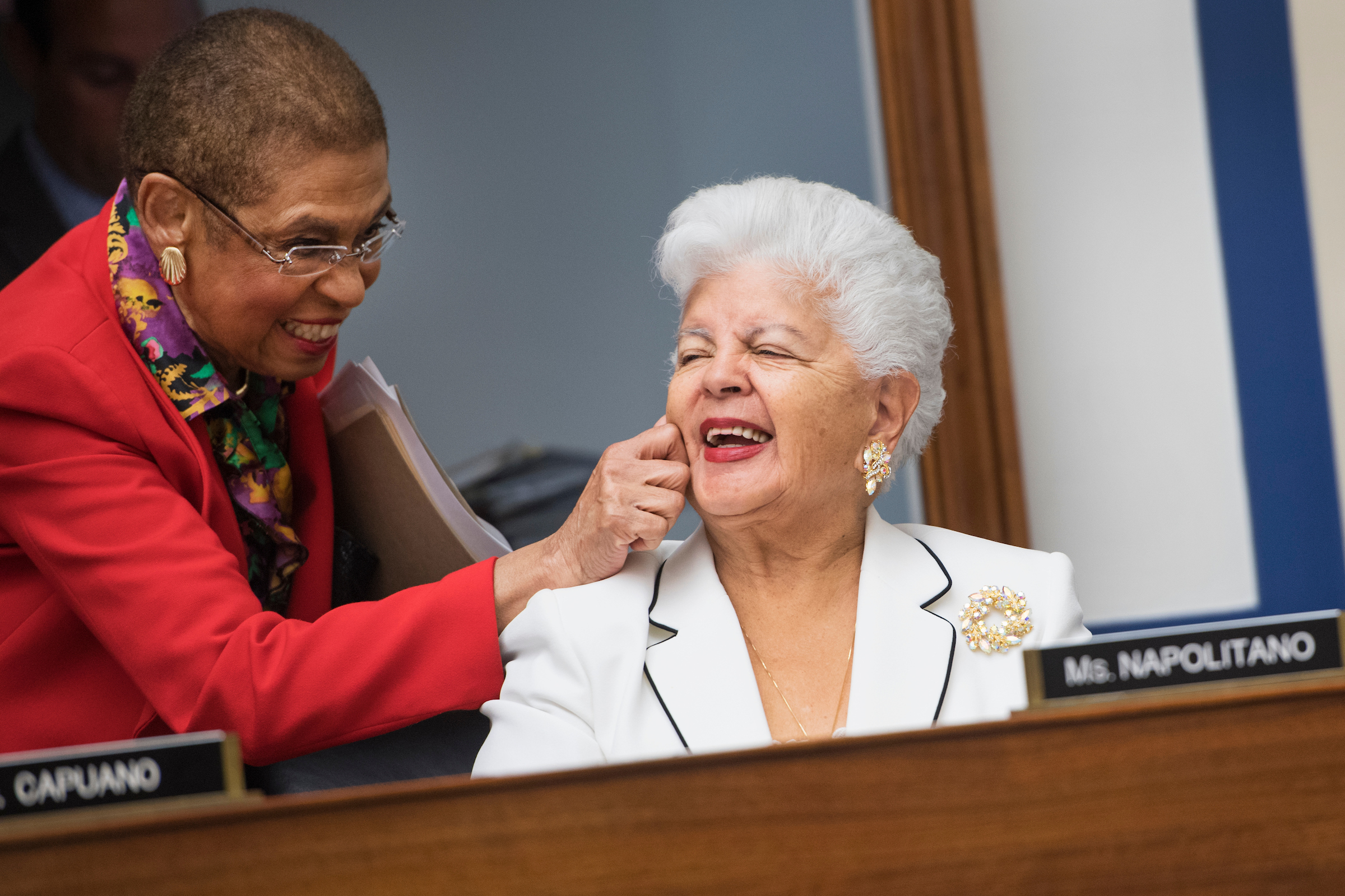 Del. Eleanor Holmes Norton, D- D.C., pinches the cheek of Rep. Grace Napolitano, D-Calif., during a House Transportation and Infrastructure Committee markup in Rayburn Building, September 14, 2016. (Photo By Tom Williams/CQ Roll Call)