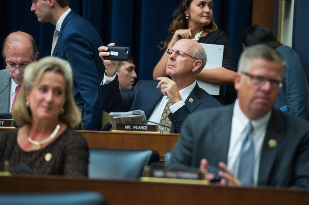 New Mexico Rep. Steve Pearce, center, attends a House Financial Services Committee hearing in the Rayburn building on Thursday, Sept. 22. (Tom Williams/CQ Roll Call)