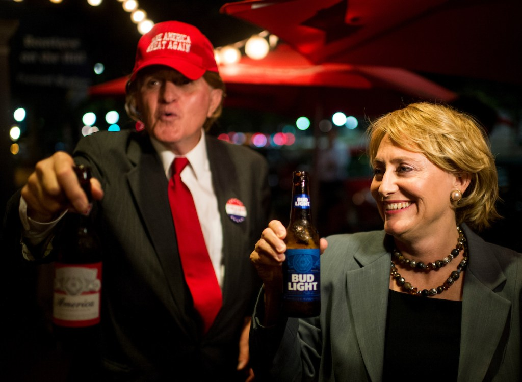 Donald Trump impersonator Dwane Starlin and Hillary Clinton impersonator Suzanna Woodhead have a beer together prior to the first presidential debate of 2016 at the Capitol Lounge in Washington on Monday, Sept. 26. (Bill Clark/CQ Roll Call)