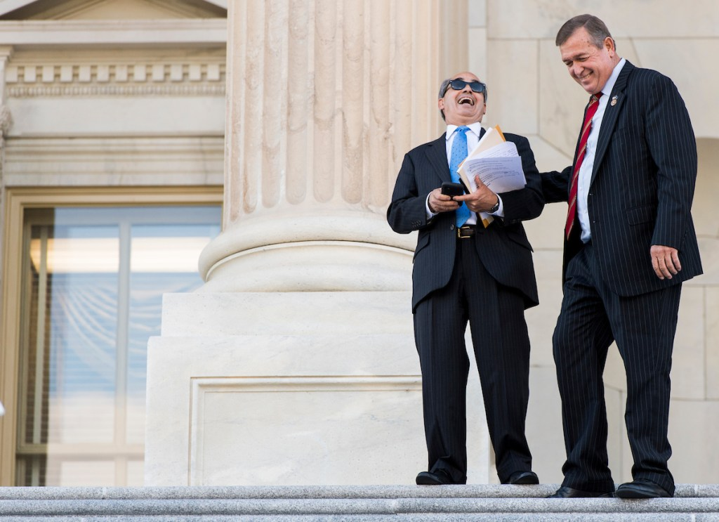 Maine Rep. Bruce Poliquin, left, and Nevada Rep. Cresent Hardy talk on the House steps after a vote in the Capitol on Tuesday, Sept. 27. (Bill Clark/CQ Roll Call)