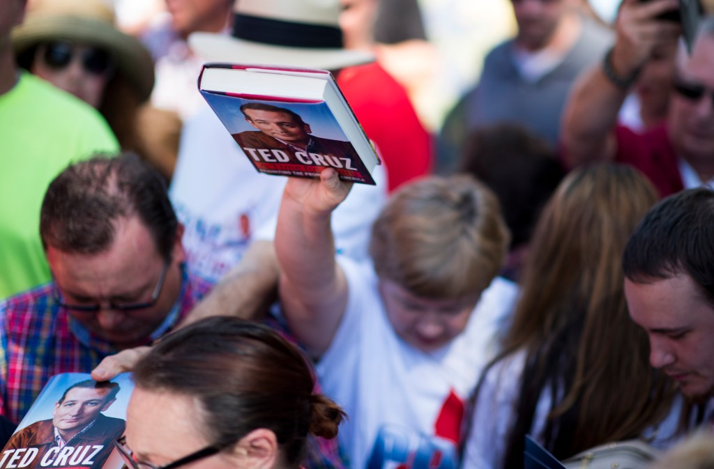 Aug. 8, 2015: Supporters try to get their books signed by presidential candidate Texas Sen. <a class=