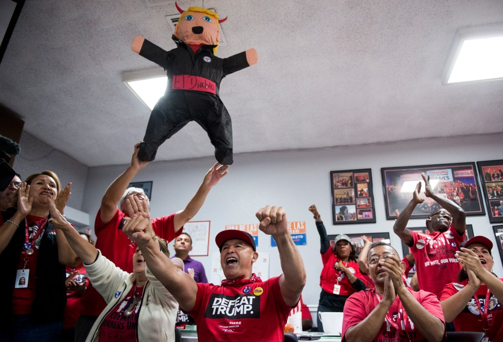 Nov. 7, 2016: Union workers cheer below a Donald Trump piñata named El Diablo during a canvassing kickoff rally with Cortez Masto and Ruben Kihuen, Democratic candidate for Nevada''s 4th Congressional District, at the influential Culinary Workers Union Local 226 in Las Vegas. The mostly Hispanic labor union is a powerhouse in Democratic politics in Nevada. (Bill Clark/CQ Roll Call)