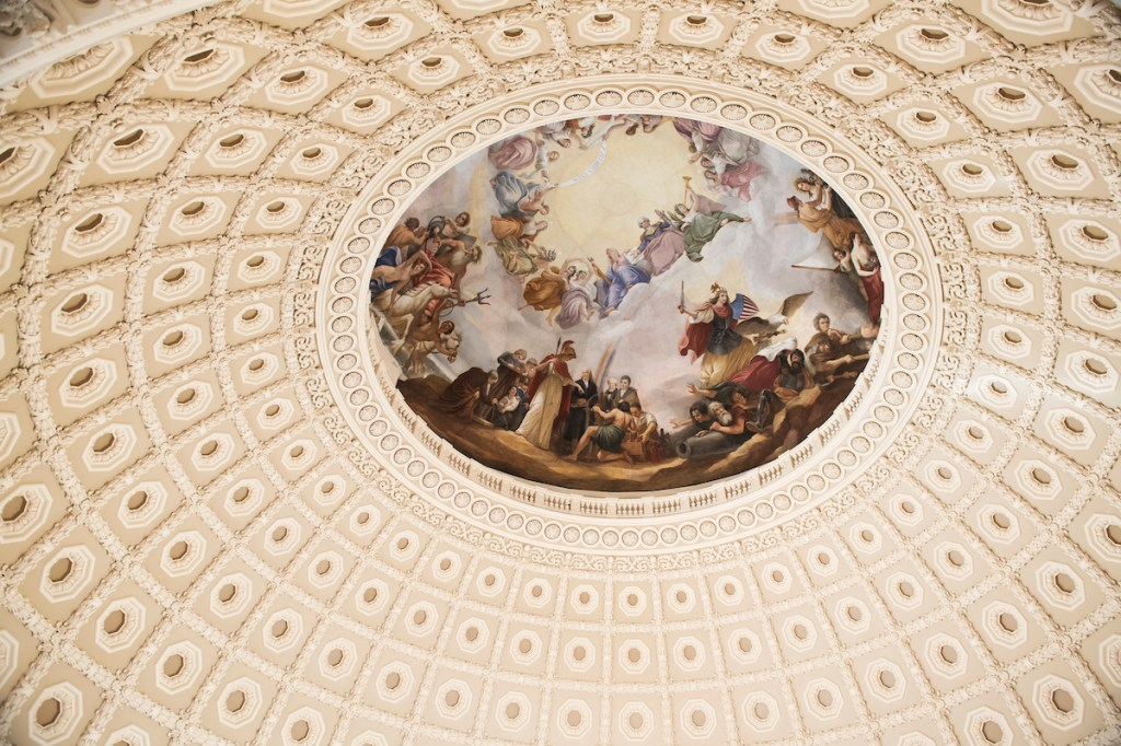 A fresco by Constantino Brumidi is pictured on the ceiling of the Capitol Rotunda during a tour the U.S. Capitol Dome after completion of the restoration project. (Tom Williams/CQ Roll Call)