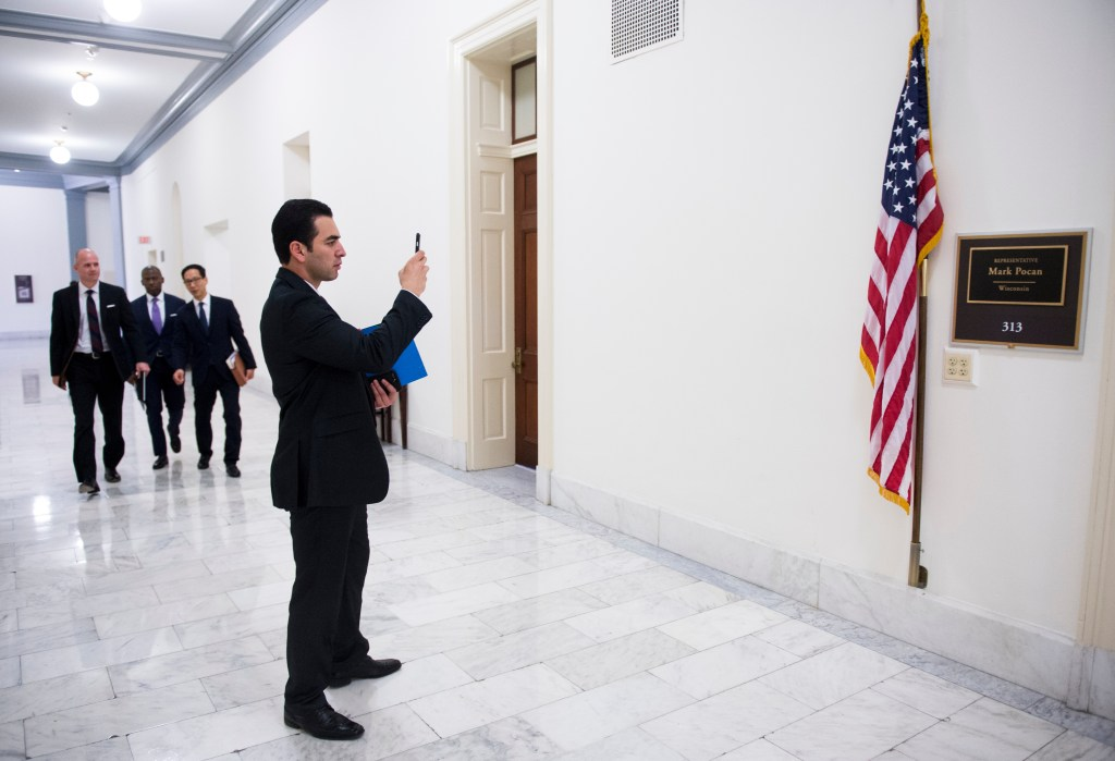 Kihuen takes photos of his new office in the Cannon House Office Building. (Bill Clark/CQ Roll Call)