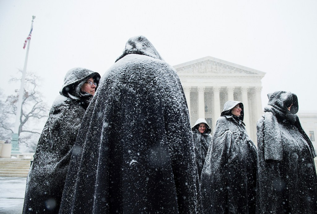 4. Jan. 22: Snow-covered nuns from the Fraternite Notre Dame in Chicago stand in front of the U.S. Supreme Court on the anniversary of Roe v. Wade, following the annual March for Life. Snow began to fall early afternoon as approaching blizzard conditions threatened to shut down the Washington area. (Bill Clark/CQ Roll Call file photo)