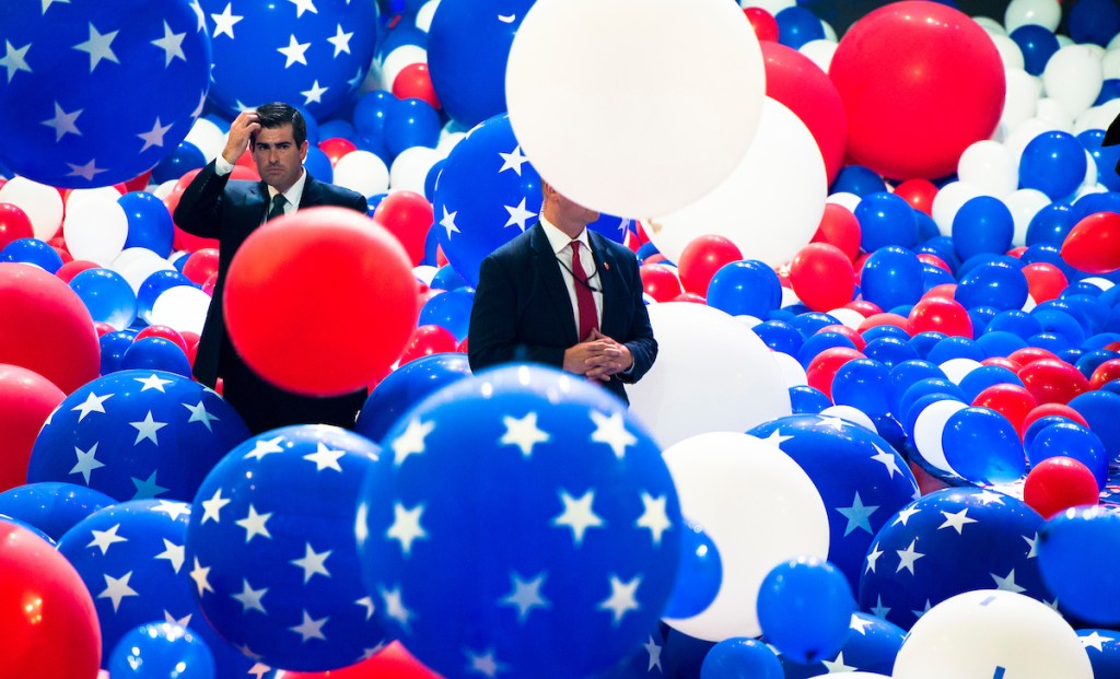18. July 28: Secret Service agents guard the stage as balloons drop at the end of the Democratic National Convention in Philadelphia. <a class=