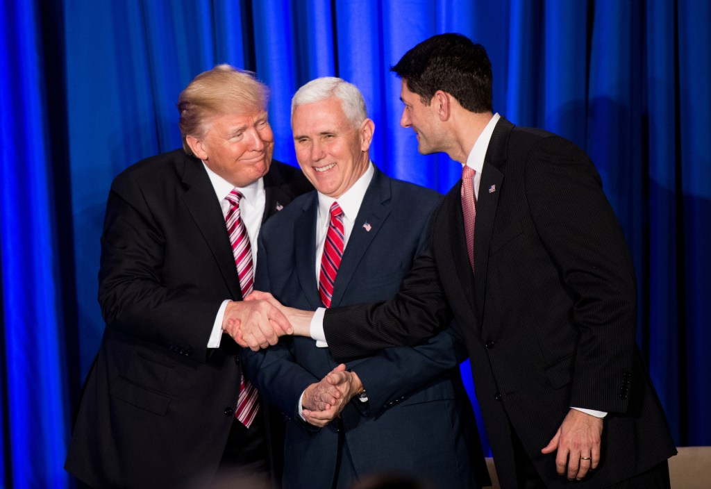 UNITED STATES - JANUARY 26: President Donald Trump, left, shakes hands with Speaker of the House Paul Ryan, R-Wisc., right, as he arrives on stage while Vice President Mike Pence looks on, at the GOP Congressional retreat in Philadelphia on Thursday, Jan. 26, 2017. House and Senate Republicans are holding their retreat through Friday in Philadelphia. (Photo By Bill Clark/CQ Roll Call/Pool)