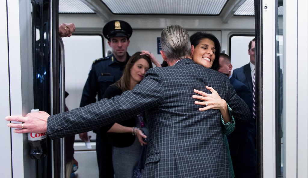South Carolina Gov. Nikki Haley, nominee to be the U.S. ambassador to the United Nations, gets a hug from Rep. Trey Gowdy, R-S.C., on the Senate subway on Thursday. (Bill Clark/CQ Roll Call)