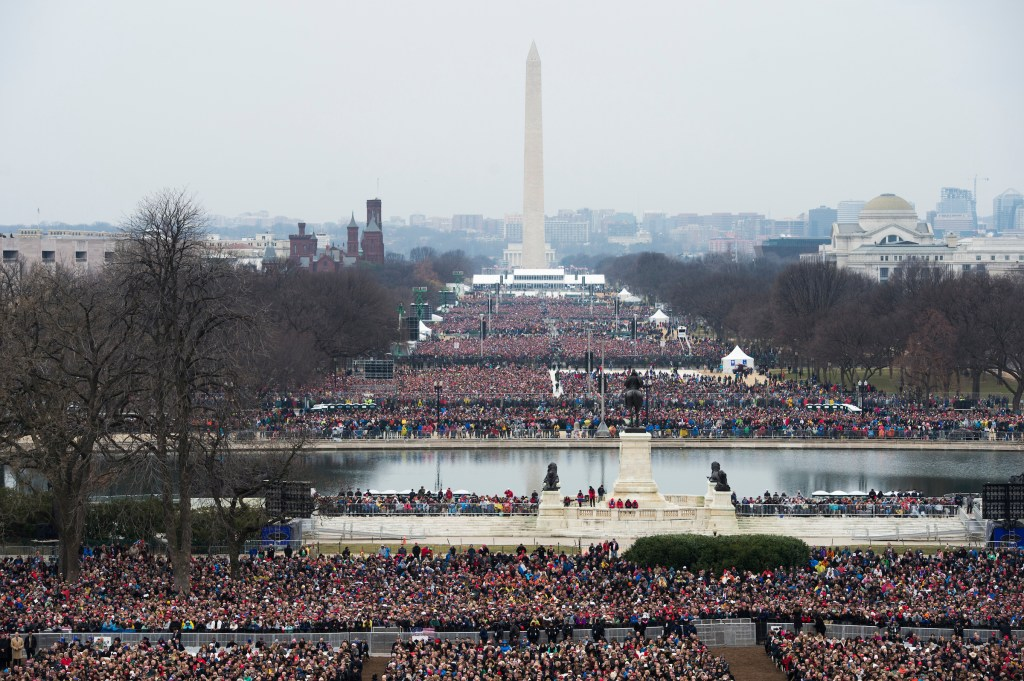 UNITED STATES - JANUARY 20: The crowd on the National Mall waits for President-elect Donald J. Trump to be sworn in as the 45th President of the United States on the West Front of the Capitol, January 20, 2017. (Photo By Tom Williams/CQ Roll Call)