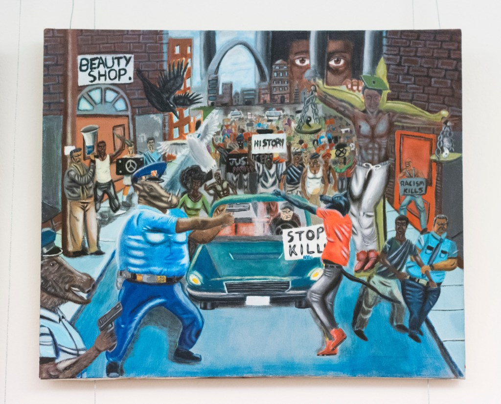 The controversial painting of community-police relations in Ferguson, Mo., by former St. Louis high school student David Pulphus depicts police officers as animals. (Bill Clark/CQ Roll Call)