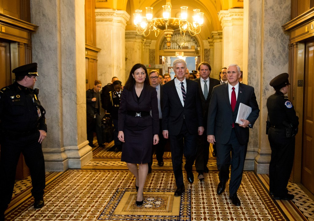 UNITED STATES - FEBRUARY 1: President Donald Trump's nominee for the Supreme Court Judge Neil Gorsuch, center, arrives in the Capitol flanked by former Sen. Kelly Ayotte, R-N.H., left, and Vice President Mike Pence as they head to their meeting with Senate Majority Leader Mitch McConnell, R-Ky., on Wednesday, Feb. 1, 2017. (Photo By Bill Clark/CQ Roll Call)