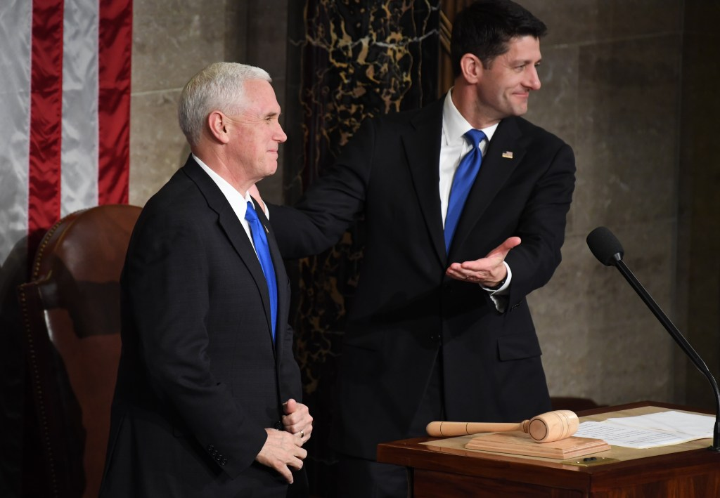 Vice President Mike Pence and Speaker of the House Paul D. Ryan, R-Wis., stand in the House chamber as Ryan gavels in the joint session of Congress where President Donald Trump will give his first address to the body. (Bill Clark/CQ Roll Call)