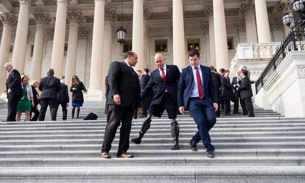 Mast counts many House Republicans among his friends in Congress, including Virginia Rep. Scott Taylor, right. Also seen in the photo from last year's freshman orientation is California Rep. Lou Correa. (Bill Clark/CQ Roll Call file photo)