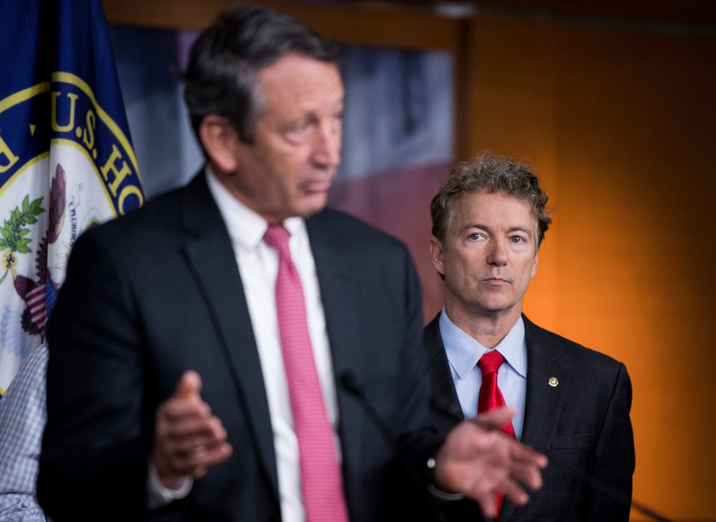 UNITED STATES - FEBRUARY 15: Rep. Mark Sanford, R-S.C., left, and Sen. Rand Paul, R-Ky., along with members of the House Freedom Caucus hold a news conference on Affordable Care Act replacement legislation on Wednesday, Feb. 15, 2017. (Photo By Bill Clark/CQ Roll Call)