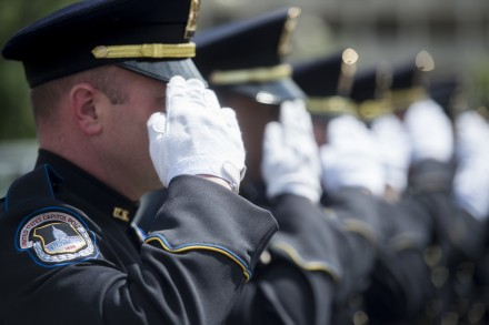 WASHINGTON, DC - MAY 11: U.S. Capitol Police honor guard members salute during the Washington Area Law Enforcement Memorial Service outside of DC Police headquarters on Monday May 11, 2015. The event held by the Fraternal Order of Police Auxiliary DC Lodge honored deceased local law enforcement officers, including U.S. Capitol Police Sgt. Clinton J Holz. (Bill Clark/CQ Roll Call File Photo)
