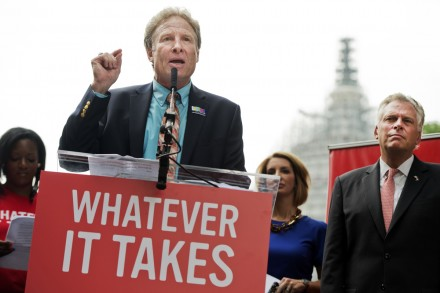 Andy Parker, whose daughter Alison, a reporter for WDBJ-TV reporter, was killed on air last month, speaks during a rally on the East Front lawn of the Capitol to demand that Congress take action on gun control legislation as Gov. Terry McAuliffe, D-Va., looks on, September 10, 2015. The event, titled #Whateverittakes Day of Action, was hosted by Everytown for Gun Safety and featured speeches by political leaders and families of gun violence victims. (Photo By Tom Williams/CQ Roll Call)