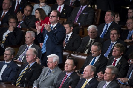 UNITED STATES - JANUARY 12: Rep. Jared Polis, D-Colo., seated in the Republican section of the House floor, stands to clap during President Barack Obama's final State of the Union address to a Joint Session of Congress in Washington on Tuesday, Jan. 12, 2016. (Photo By Bill Clark/CQ Roll Call)