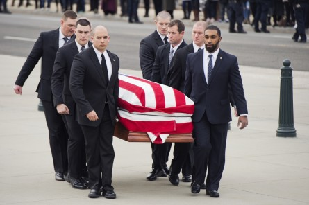 UNITED STATES - FEBRUARY 19: Pallbearers carry the body of Justice Antonin Scalia into the Supreme Court where his body will lie in repose, February 19, 2016, ahead of his burial tomorrow. (Photo By Tom Williams/CQ Roll Call)