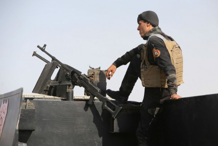 A member of the Iraqi interior ministry's anti-terrorism forces stands guard on a vehicle outside the Habaniyah military base, near Anbar province's capital Ramadi, on May 8. (AHMAD AL-RUBAYE/AFP/Getty Images)