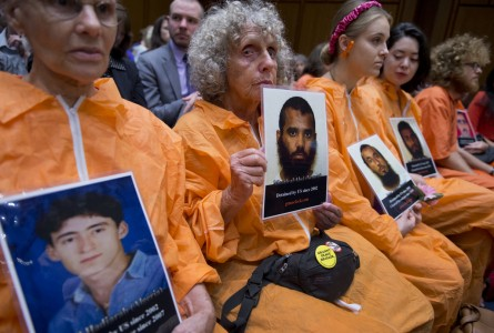Bev Rice, second from left, of New York City, and others hold pictures of detainees during a Senate Judiciary Constitution, Civil Rights & Human Rights Subcommittee hearing in Hart Building to examine the closing of the Guantanamo Bay detention camp focusing on the
