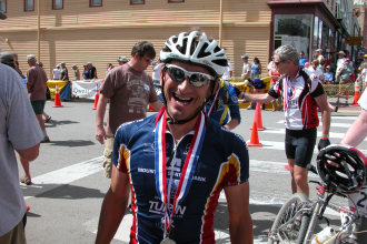 Brophy poses for a photo following a race. (Courtesy Greg Brophy Campaign website)