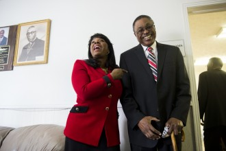 Sewell speaks with Aubrey Larkin, assistant principal at Selma High School when she was a student there, at the Brown Chapel AME Church in Selma, Ala., on Feb. 15. (Bill Clark/CQ Roll Call)