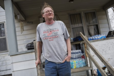 UNITED STATES - FEBRUARY 22: Doug Wiseley is pictured outside of his home in Flint, Mich., where cases of bottled water are stacked on his porch, February 22, 2016. The water supply was not properly treated after being switched from Lake Huron to the Flint River and now contains lead and iron. (Photo By Tom Williams/CQ Roll Call)