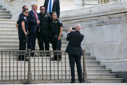 UNITED STATES - September 9: Republican presidential candidate Donald Trump takes a photo with members of the Capitol Police after a rally organized by Tea Party Patriots on Capitol Hill in Washington, Wednesday, Sept. 9, 2015, to oppose the Iran nuclear agreement. (Photo By Al Drago/CQ Roll Call)
