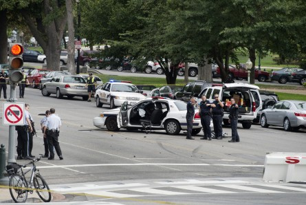 U.S. Capitol Police inspect a police car after a shooting and subsequent police car crash on Constitution Avenue and 1st. Street, NW. The officer was injured in the car crash. (Photo By Tom Williams/CQ Roll Call)