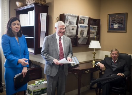 Ayotte, left, and other GOP Senators chat before a Wednesday press conference on offseting jobless benefits. (Bill Clark/CQ Roll Call)