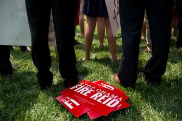 firereid102714 445x296 Democrats Run From Harry Reid