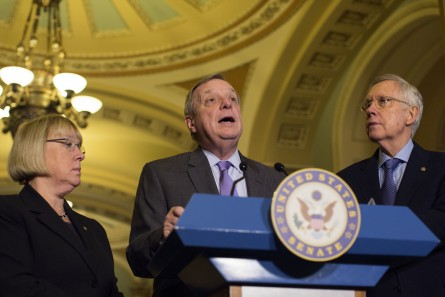 UNITED STATES - DECEMBER 1 - Sen. Richard Durbin, D-Ill., speaks as Sen. Patty Murray, D-Wash., and Senate Minority Leader Harry Reid, D-Nev., listen during the weekly Senate luncheon news conference on Capitol Hill, in Washington, Tuesday, December 1, 2015. (Photo By Al Drago/CQ Roll Call)
