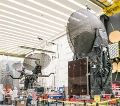 TDRS L (left) and TDRS K (right) In the satellite factory Boeing photo