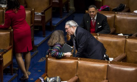 UNITED STATES - JANUARY 20: Rep. G.K. Butterfield, D-N.C., catches Rep. Diana DeGette, D-Colo., after she trips on the raised seating platform as she arrives for President Barack Obama's State of the Union address in the Capitol on Tuesday, Jan. 20, 2015. (Photo By Bill Clark/CQ Roll Call)