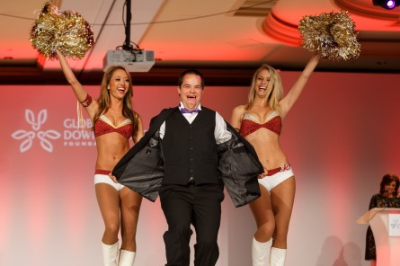 Alex Sessions with two Redskins cheerleaders.