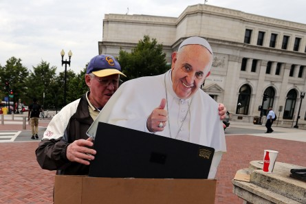 UNITED STATES - September 21: Mike Normile, of Cleveland, Ohio, packs up his cardboard cutout of Pope Francis after offering people the chance to take a picture with it in front of Union Station in Washington, Monday, September 21, 2015. Normile paid $160 for the cutout and plans on coming out every day this week before Pope Francis' visit to Washington. (Photo By Al Drago/CQ Roll Call)
