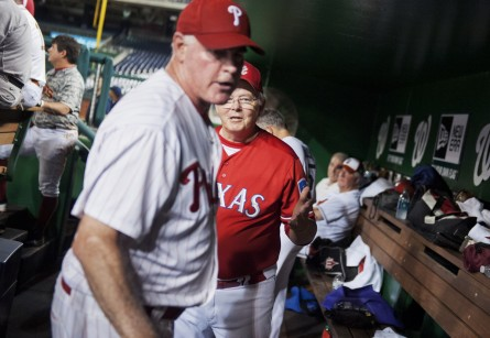 Manager Joe Barton, R-Texas, tries to calm down Rep. Patrick Meehan, R-Pa., in the Republican dugout after Meehan was pulled from the mound during the 2014 game. (Tom Williams/CQ Roll Call File Photo)