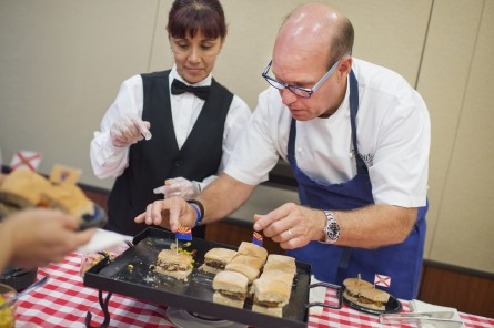 Gray, right, puts the final touch on a veggie plate. (Tom Williams/CQ Roll Call)