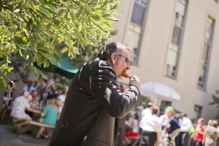 Rep. Doug LaMalfa goes all in on a corn dog. (Tom Williams/CQ Roll Call)