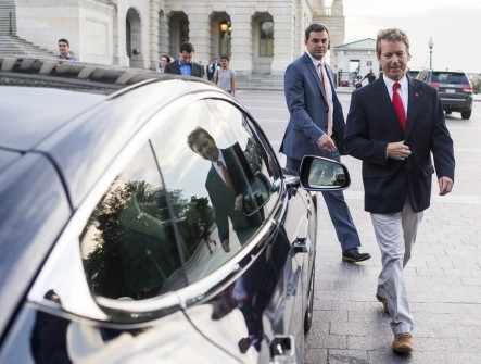Amash and Paul approach Massie's Tesla leaving the Senate's Sunday session. (Bill Clark/CQ Roll Call)
