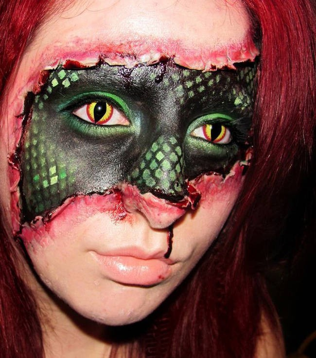 Who can stand looking at this woman with a snake eyes for more than a minute?