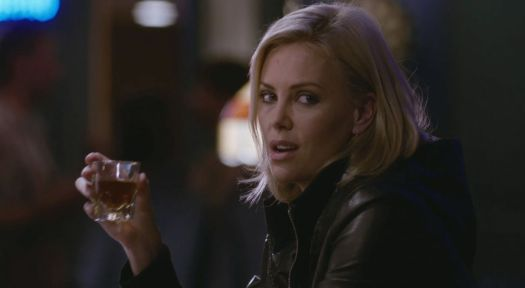 Young Adult: Charlize Theron sips a whiskey at a bar