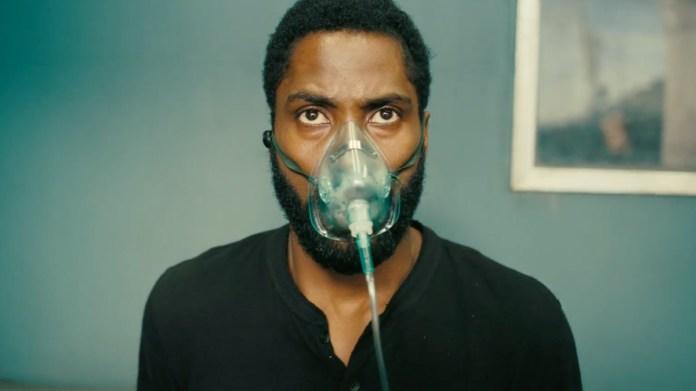 john david washington with an oxygen mask on his face in tenet