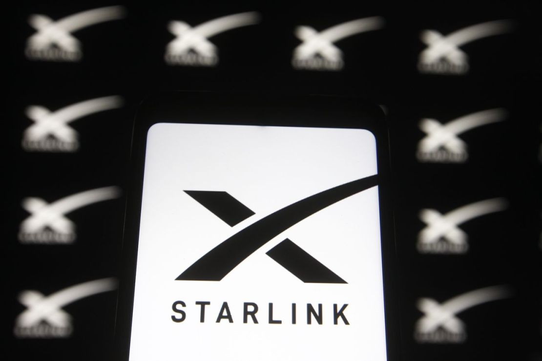 In this photo illustration a Starlink logo of a satellite...