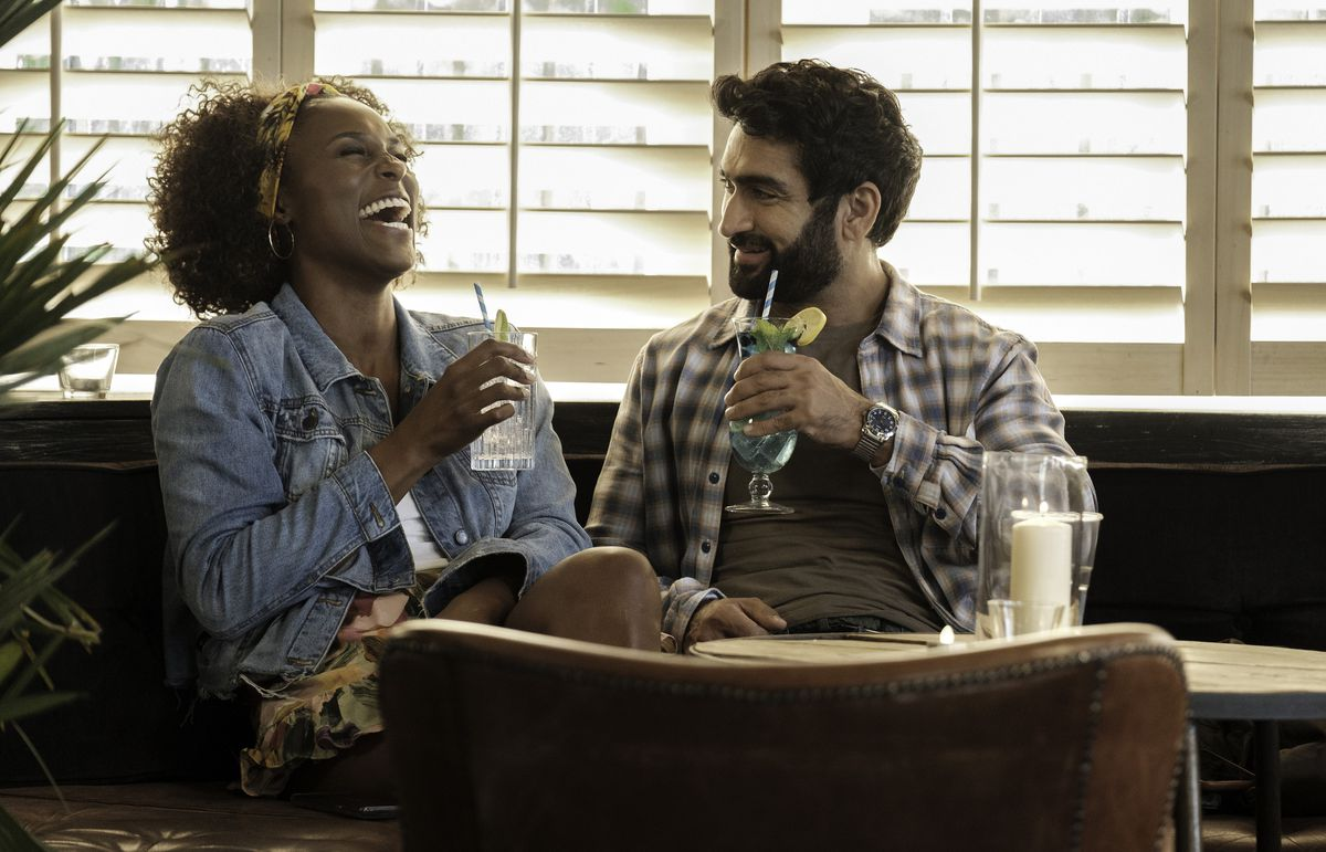 issa rae and kumail nanjiani laugh over drinks