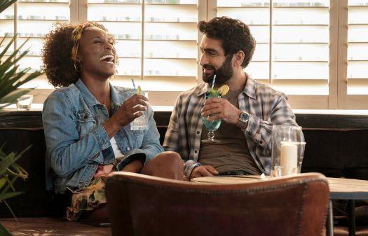 issa rae and kumail nanjiani laugh over drinks