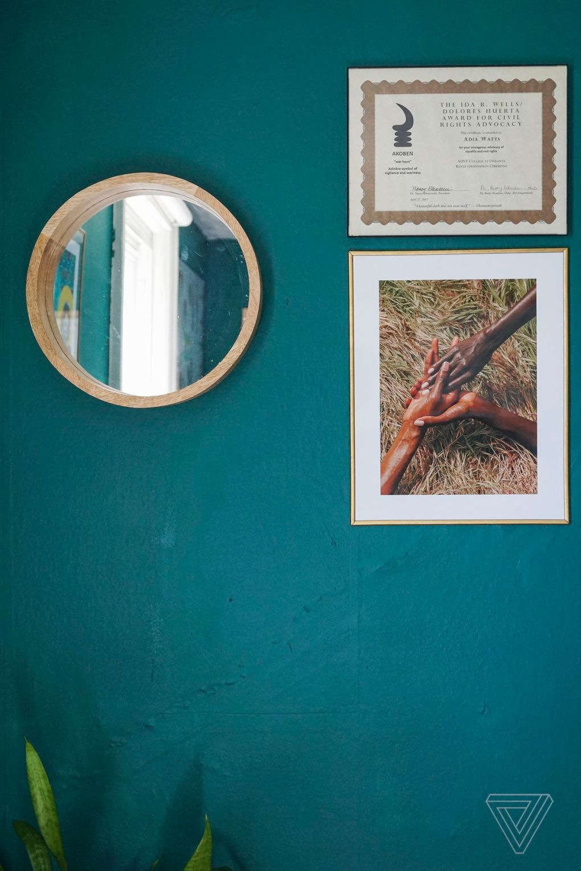 A mirror, an award, and a photograph