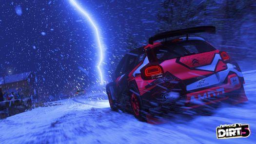 A car in Dirt 5 speeds through a snow and lightning storm