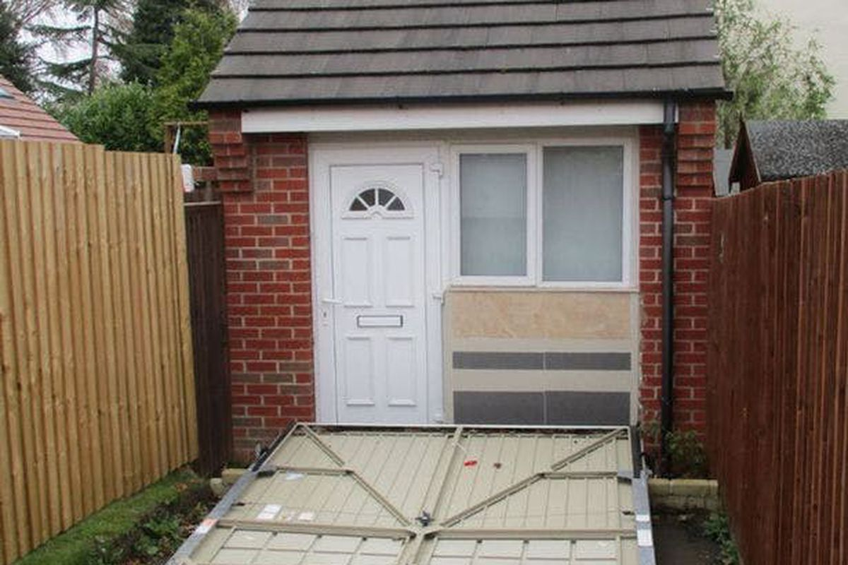 U K  couple used a fake garage door to hide illegal tiny house   Curbed Photo from Blaby district council PA
